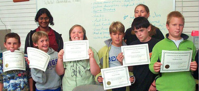 Group of young students with an award